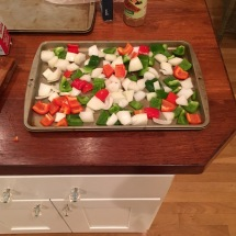 Peppers and onions ready to roast.
