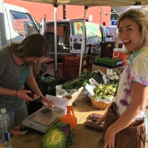 Jess buying cauliflower and frisée from Suzie's Farm
