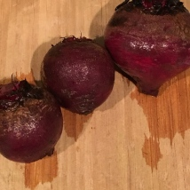 Red beets, scrubbed and ready to be wrapped