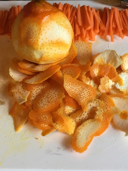 Peeled oranges and matchstick carrots