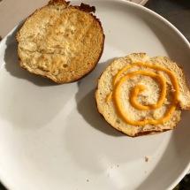 Toasted pretzel bun, plus a drizzle of spicy Sriracha mayo