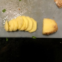 I peeled fresh ginger, then thinly sliced a section before chopping it into smaller pieces