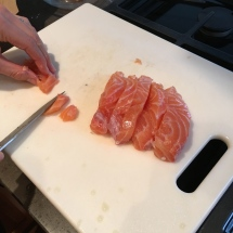 Cutting the salmon into cubes