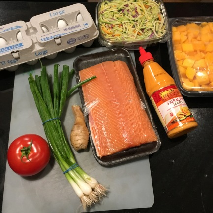 Fresh ingredients laid out for salmon burger prep.