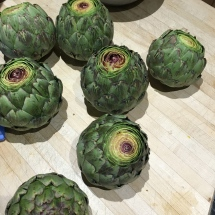 We sliced off the tops of our artichokes, but you can leave them whole to steam.