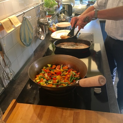The large wok and cast iron pan in action.
