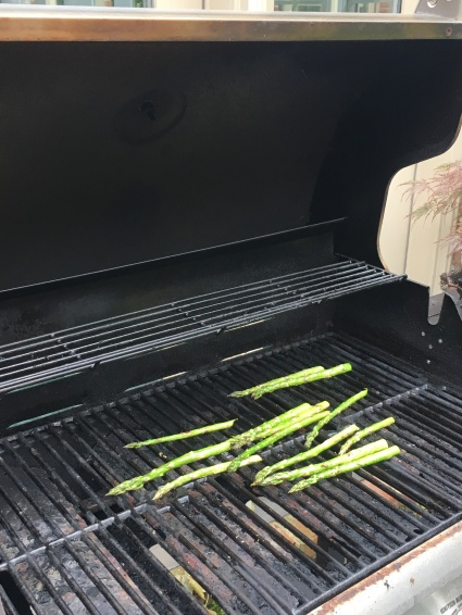Rolling the asparagus to get grill marks.