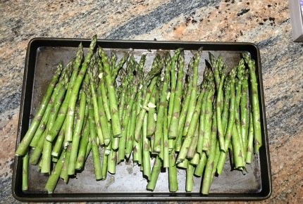 First we rinse the asparagus and then snap off the stalk ends.