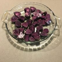 Small purple potatoes, post-roasting.