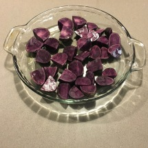 Small purple potatoes, post-roasting.