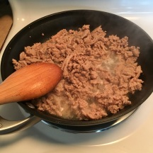 In a separate pan, brown ground turkey.