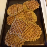 We keep the waffles warm at 250 degrees Fahrenheit in the oven.