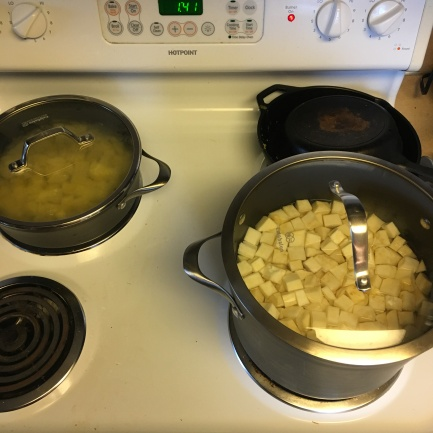 Boil potatoes and celery root in two separate pots.