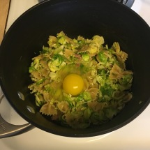 I scooped one serving of pasta into a small pot and added one large egg.