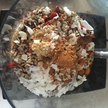 Wet and dry ingredients in the food processor, before pulsing.
