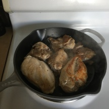 After about five minutes, chicken is nice and brown on one side.