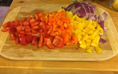 Three colors of bell peppers, plus red onion for good measure.