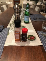 Salt and peppers on the table runner.